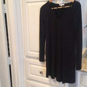 Black dress with cross cross detail at neck
